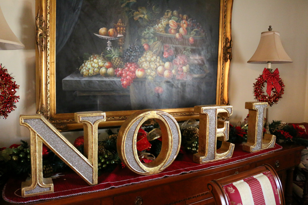 "NOEL - I cover the buffet with garland and this NOEL decor. I love it. Sometimes the ""Elf on the Shelf"" plays tricks on me and moves the letters around. He like to spell out LEON?! I think that might be his name. LOL"