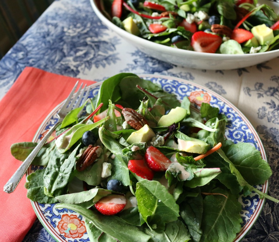 Berry Basil Harvest Salad loaded with fresh basil, candied pecans, blue cheese, blueberries and strawberries. Perfection!