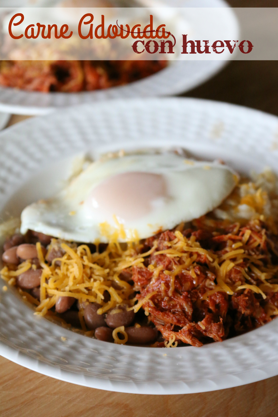 Carne Adovado Con Huevo - Carne Adovado Con Huevo - Pork marinated in Red Chile served with a fried egg.