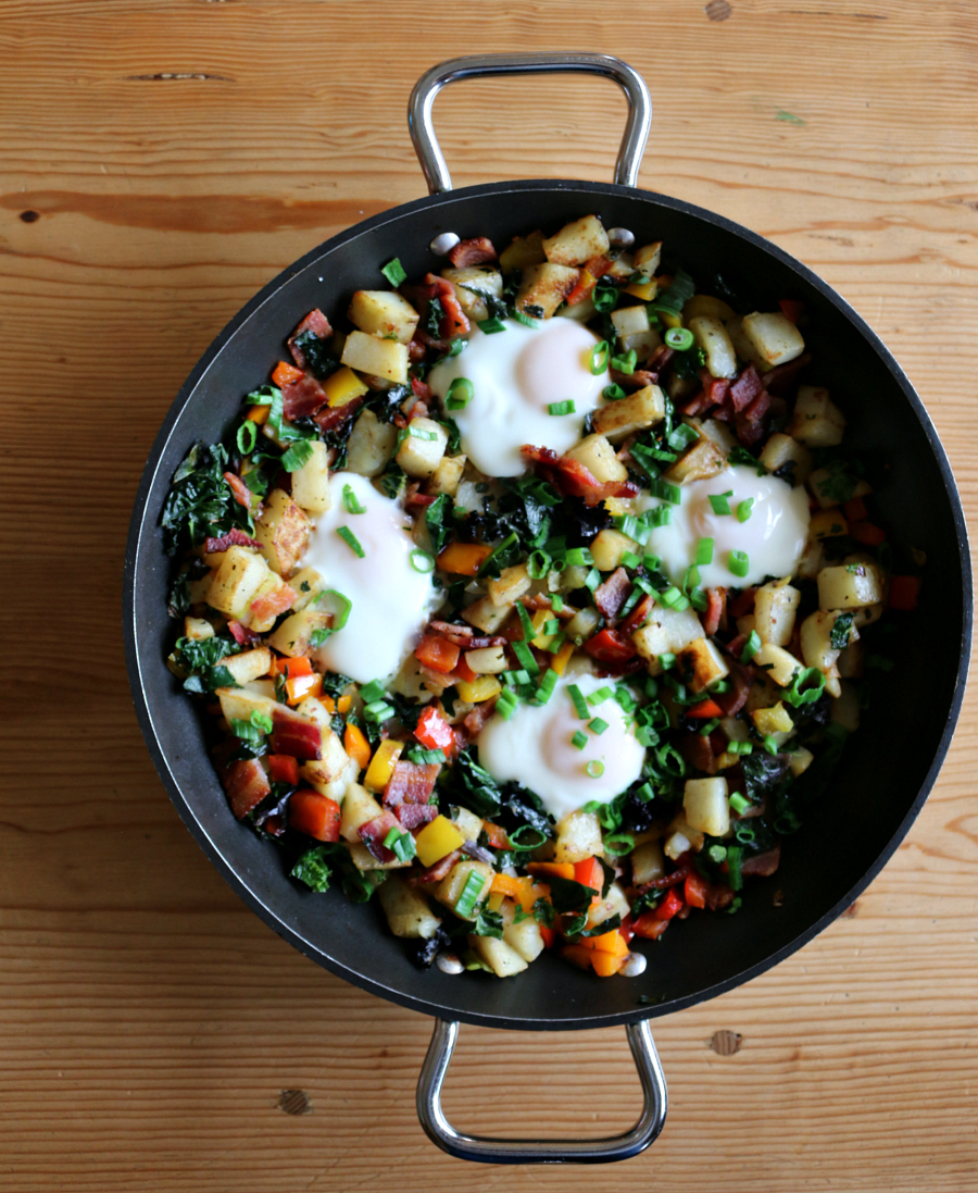 Breakfast never tasted this good . . . loads of vegetables, like potatoes, colorful bell peppers, scallions, rainbow kale, and topped with chopped bacon and eggs.   CeceliasGoodStuff.com