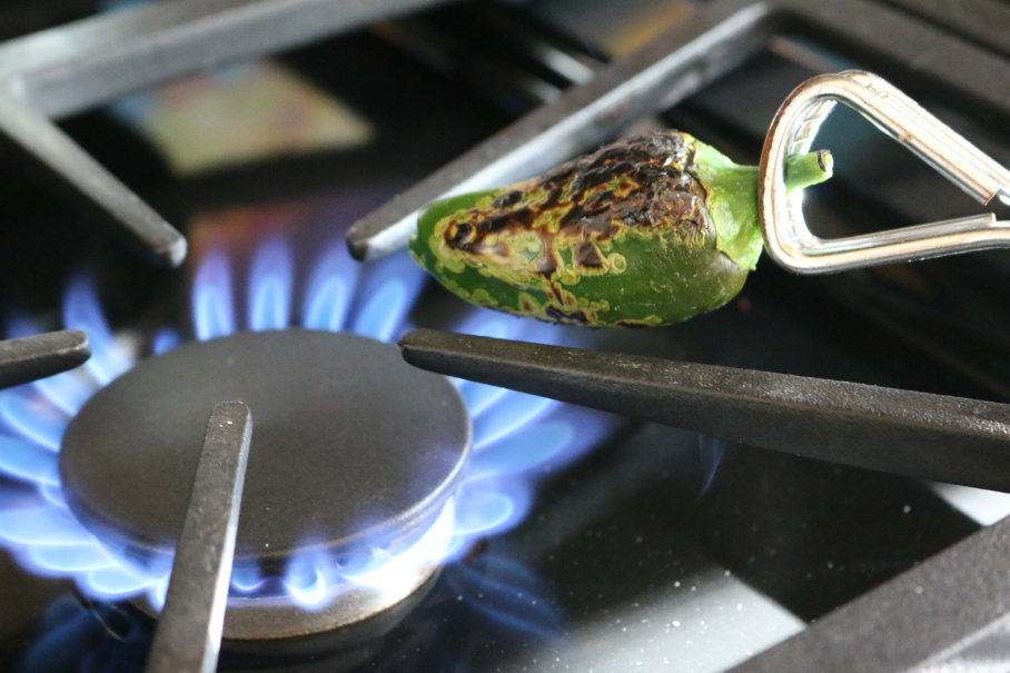 Roasting Jalapenos over an open flame CeceliasGoodStuff.com Good Food for Good People