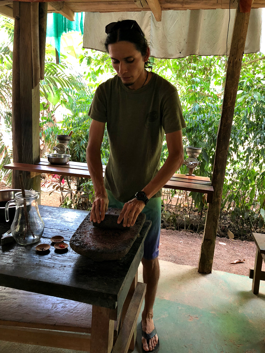 George crushing chocolate to make truffles. La Iguana Chocolate, Costa Rica