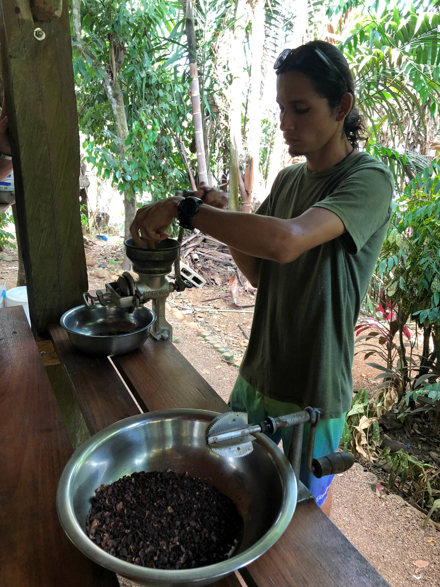 George crushing the cocoa beans to make cocoa. La Iguana Chocolate Costa Rica